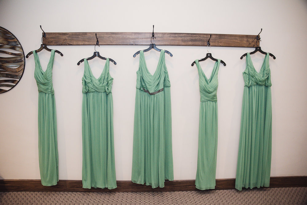 bridesmaid dresses hanging on the wall