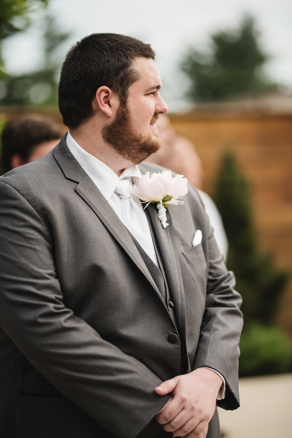 groom watching bride walk down the aisle at columbus ohio wedding