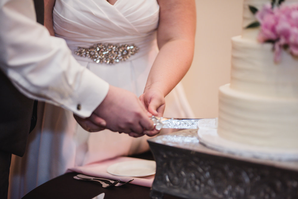 couple cutting their cake