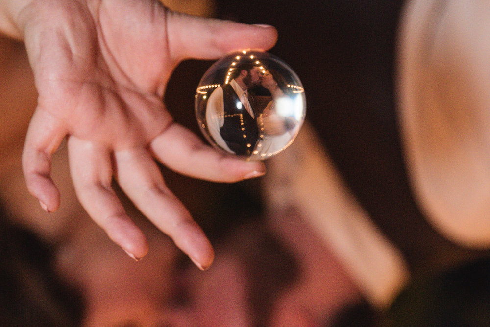 lensball photo of bride and groom