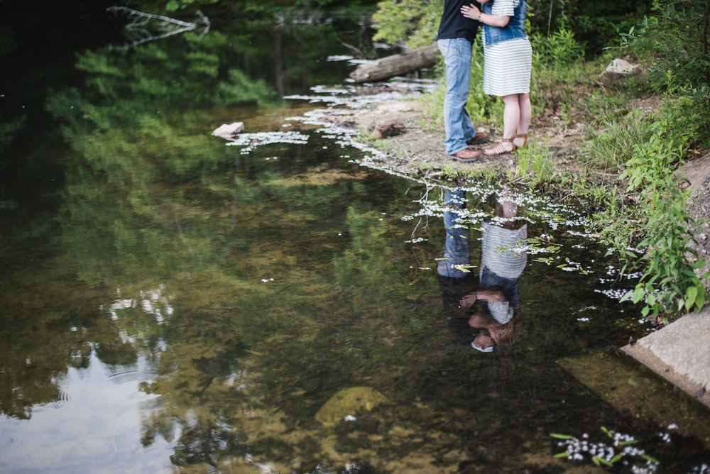 lake reflection couple kissing alley park engagement