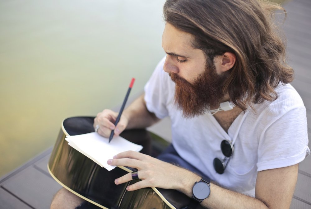 Guy writing buitar.jpg