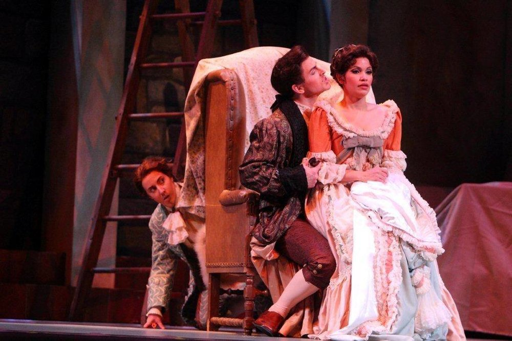 Cherubino ( Le nozze di Figaro ) at Dayton Opera, hiding from Andrew Garland as the Count & Zulimar Lopez as Susanna (Credit: Scott Kimmins)