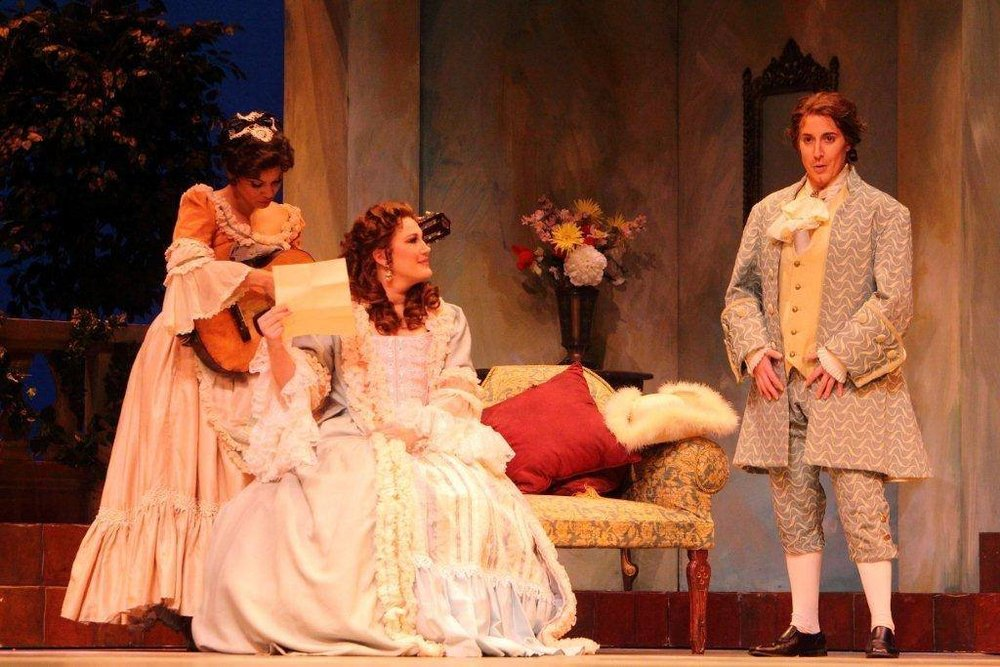Cherubino ( Le nozze di Figaro ) at Dayton Opera, serenading Rebecca Davis as the Countess & Zulimar Lopez as Susanna (Credit: Scott Kimmins)