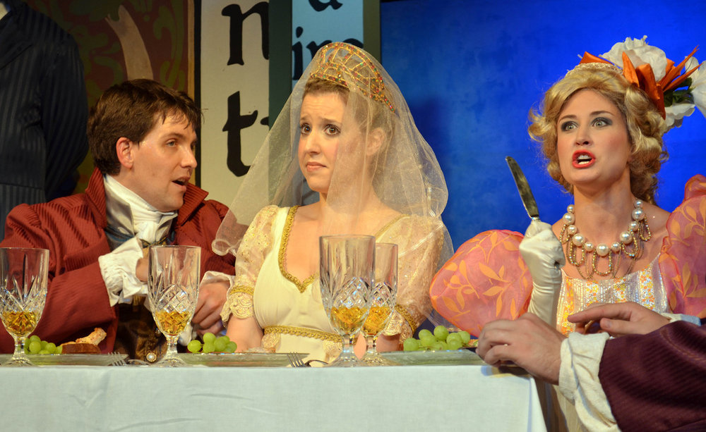 Angelina ( La Cenerentola ) at the ball, with John Dooley as Dandini and Martha O'Hara as Clorinda. (Credit: Robert Stone)