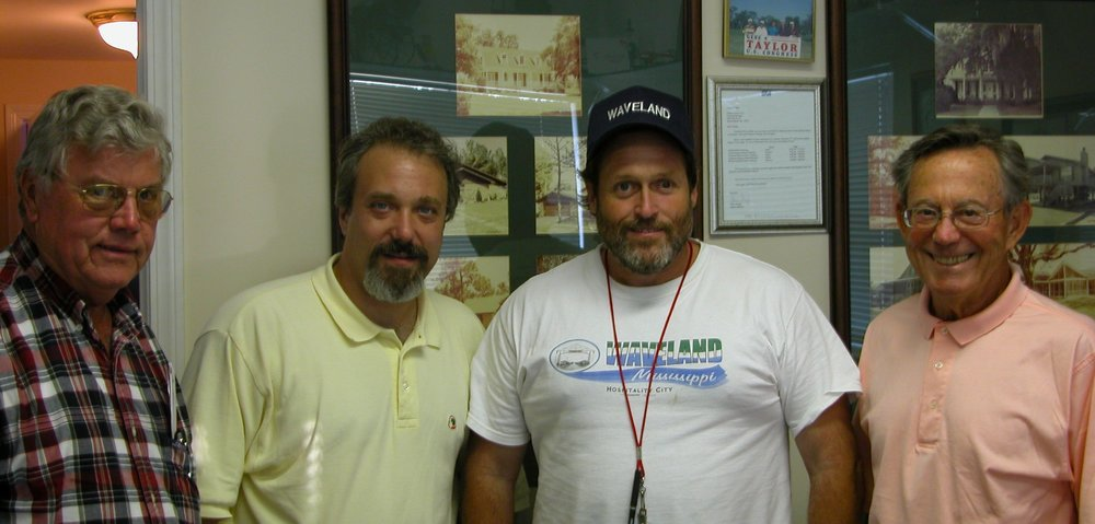 1. In fall of 2005, a team of leaders from Dalton visited the Gulf Coast to determine how the Community Foundation and other Northwest Georgia businesses could assist in the cleanup and recovery after Hurricane Katrina hammered the region. Pictured are: Charlie Johnson, David Aft (President of the Foundation), Tommy Longo (Mayor of the city of Waveland, Mississippi), and Norris Little (Foundation volunteer and Dalton business leader). George Woodward and Richard Fairey made the trip but are not pictured.
