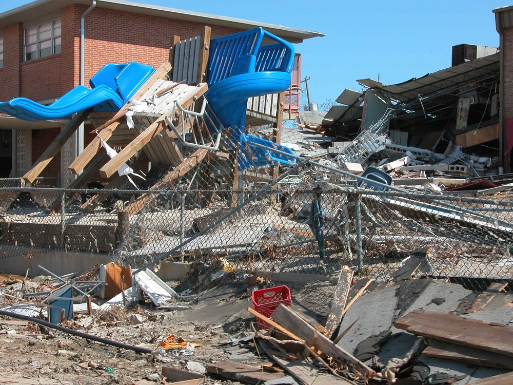9. Photo shows the remnants of a playground smashed against the side of an elementary school.