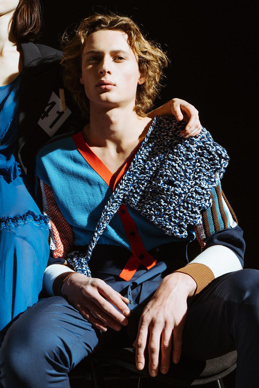 Ilona wears dress PREEN LINE, jacket VIVIENNE WESTWOOD, shoes MM6. Cyriel wears trousers VIVIENNE WESTWOOD, jumper TOGA PULLA, knit scarf CONGREGATION.