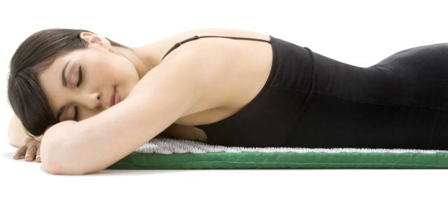 You can treat headaches by laying your cheek and body on the mat.