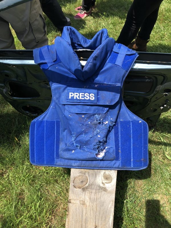 A press jacket with a bulletproof vest that has been hit by gunfire. (Rebecca Gibian/RealClearLife)