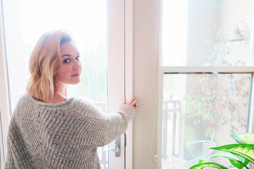 Blonde-bob-gold-hoops-gray-sweater-sunshine-house-plants.jpg