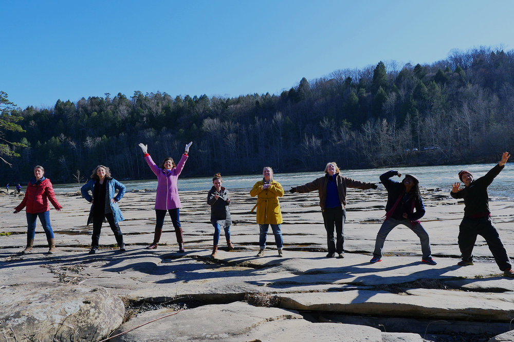 Members of the second Ridgeway cohort in power poses at Cumberland Falls State Park. (photo by Aaron Phelps)