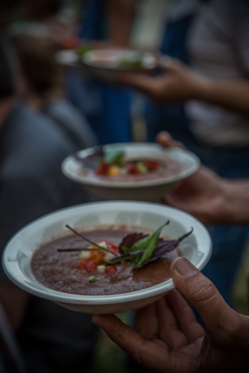 Bowls of farm-fresh soup served at a prior Clear Creek performative feast prepared by local chef Adam Burke.  (photo by Melisa Cardona)