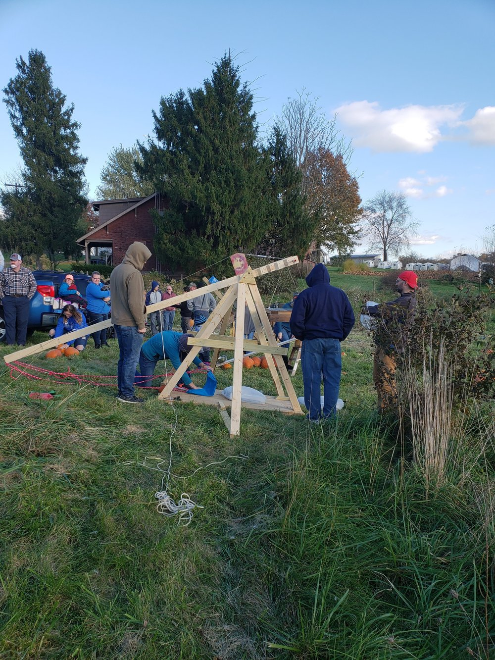 The trebuchet being prepped to launch.