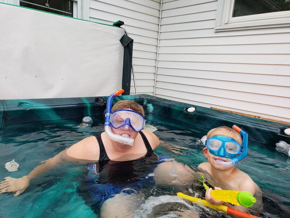 Susan and our nephew Evan snorkeling in the hot tub during Aunt Camp.