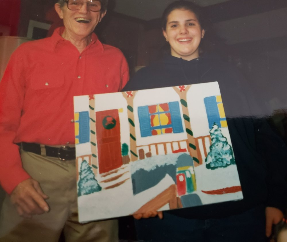 Me and my Pappy with a picture I painted. Remember I said I was not a good painter.
