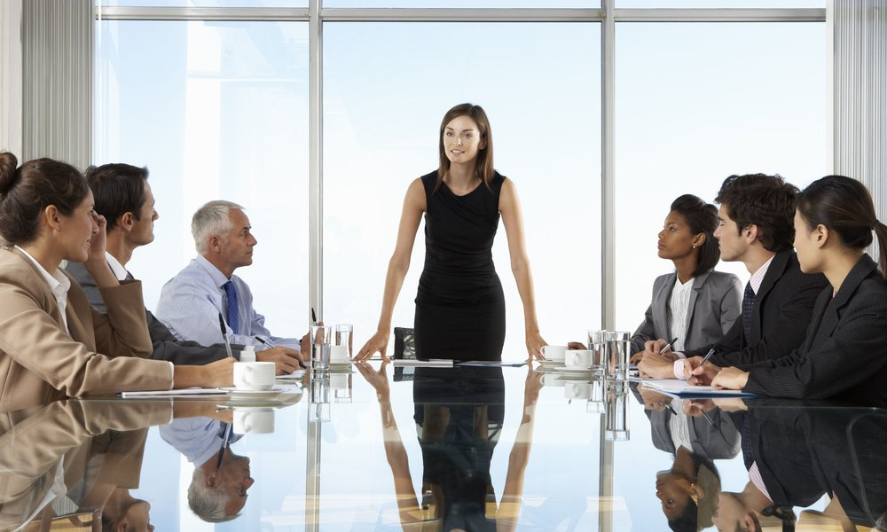 female-CEO-leading-board-meeting.jpg