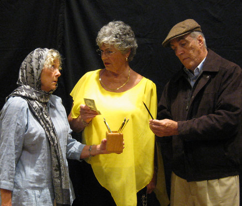 Pictured left to right: Judith Kimball ( Nancy Markey ) First Passerby ( Una Glaser ) Second Passerby ( Ross Wilkinson ) Judith is selling pencils? What has happened?