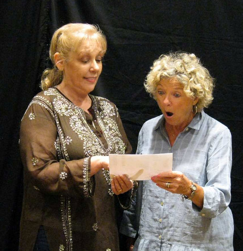 Pictured left to right: Ms. Akins (Barb Abrams ) Judith Kimball (Nancy Markey ) What is Ms. Akins from Eternal Gardens showing to Judith?