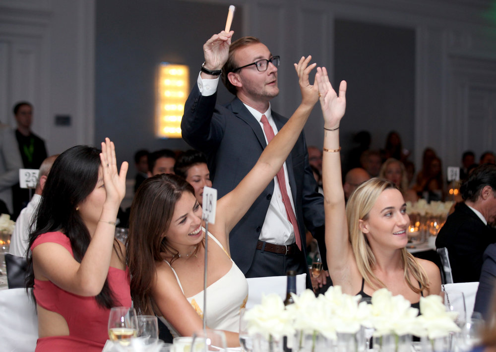 Guests participating in the Live Auction (Photo by Getty Images)