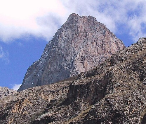 The imposing granite monolith La Esfinge in Peru's Paron Valley. Home to several big wall routes and over 5,000m elevation it's original route (750m, 5.11) is on the Vertical Year route list. (Source: La Esfinge SummitPost page)