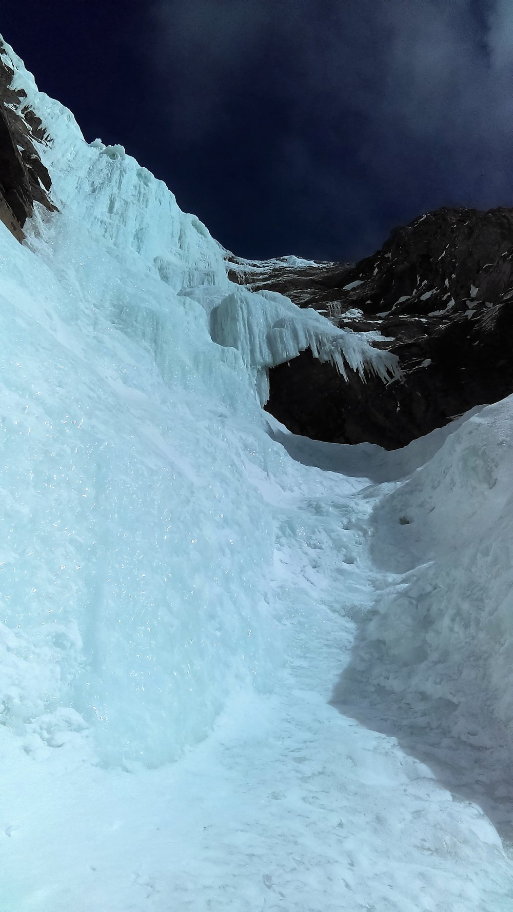 The upper section of the route. We soloed the WI2 gully to the right to the belay station in the cave.