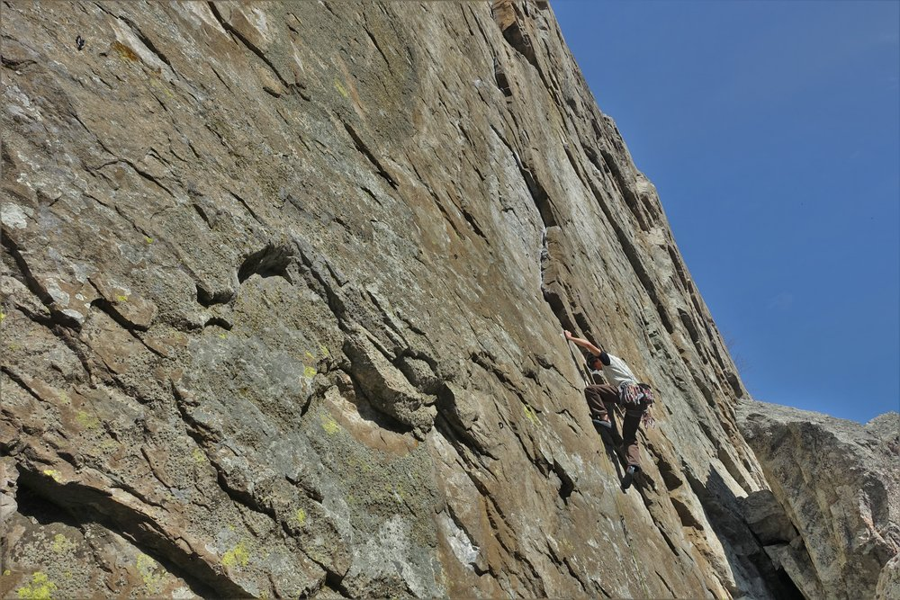 Jaz on his onsight attempt of a climb called 'Falling into Blackness' (5.10d/21) in the Doctors Wall sector.