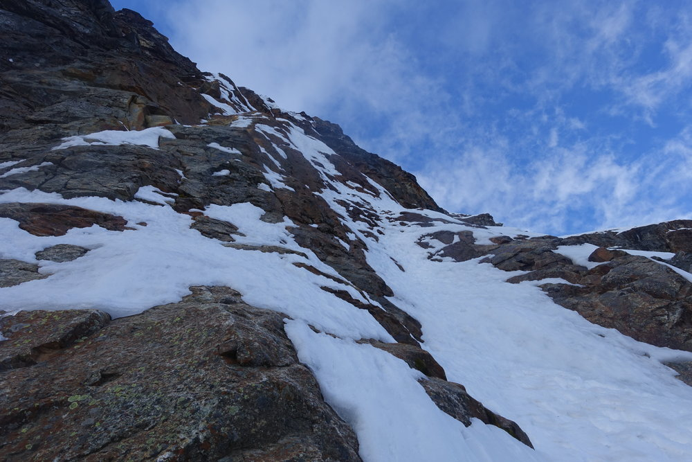 The first technical pitch of the climb followed a thin snow ramp through moderate mixed terrain.