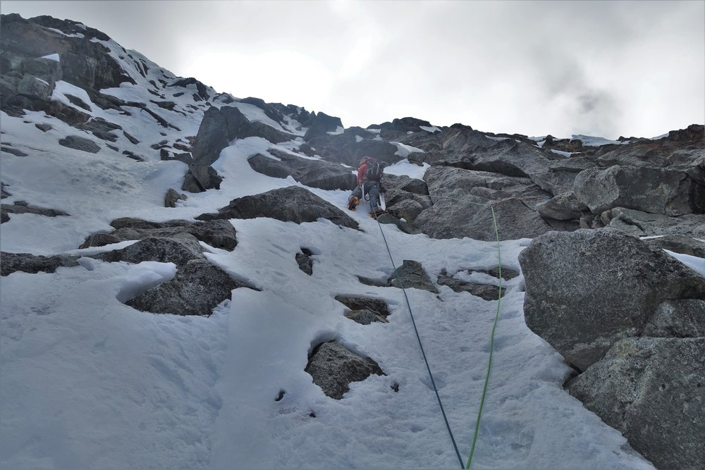 Typical mixed terrain above the crux of the route. Fun and engaging climbing.
