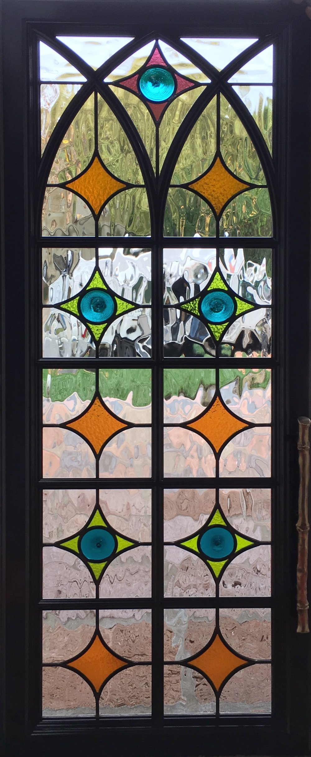 traditional pattern geometric classic design rondel spanish design gothic arched cabinet door leaded glass stained glass legacy glass atherton san jose menlo park san francisco california.jpg