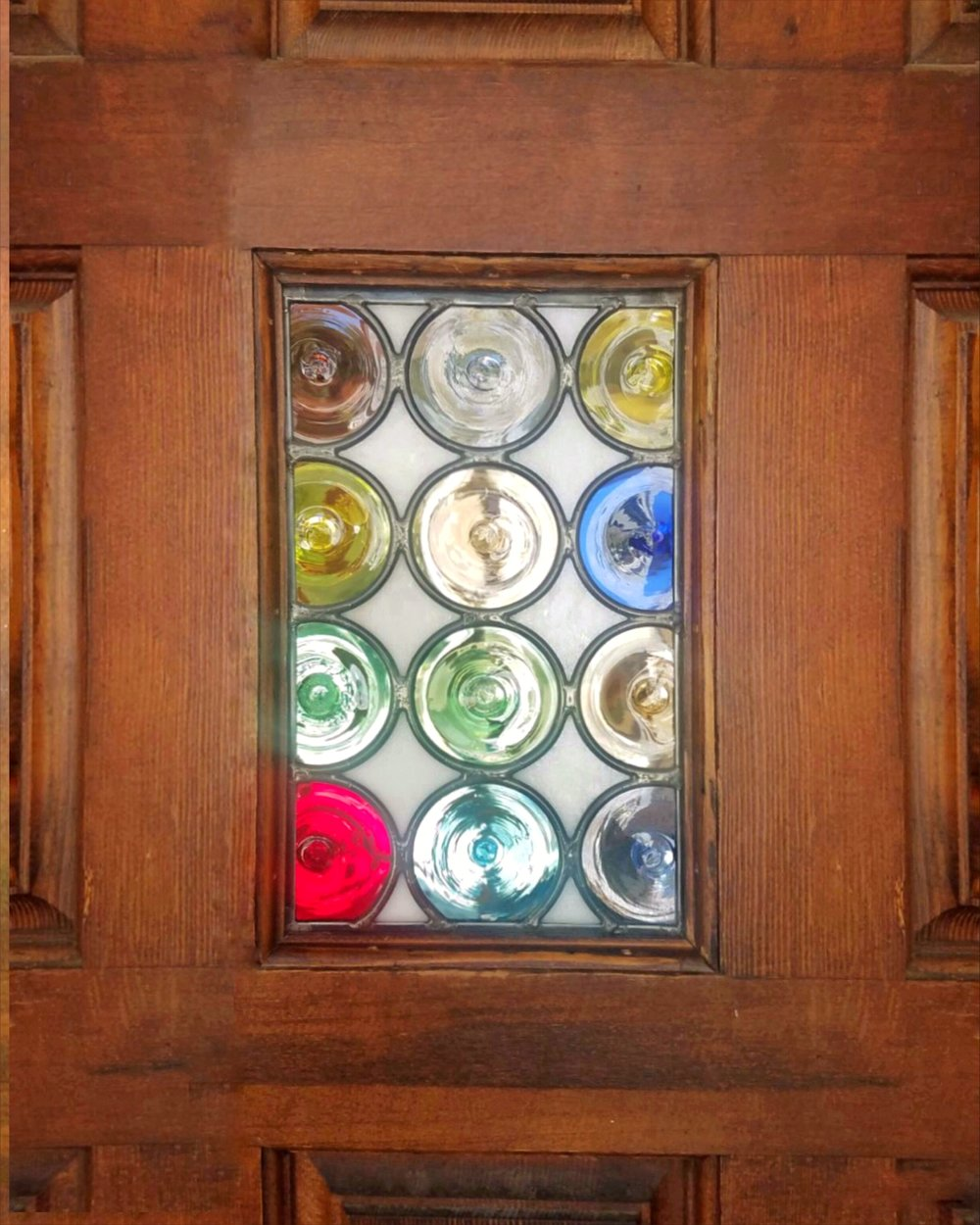 leaded glass stained glass custom design california legacy glass studios mouth blown rondels colorful fun circles modern custom front door repair.JPG