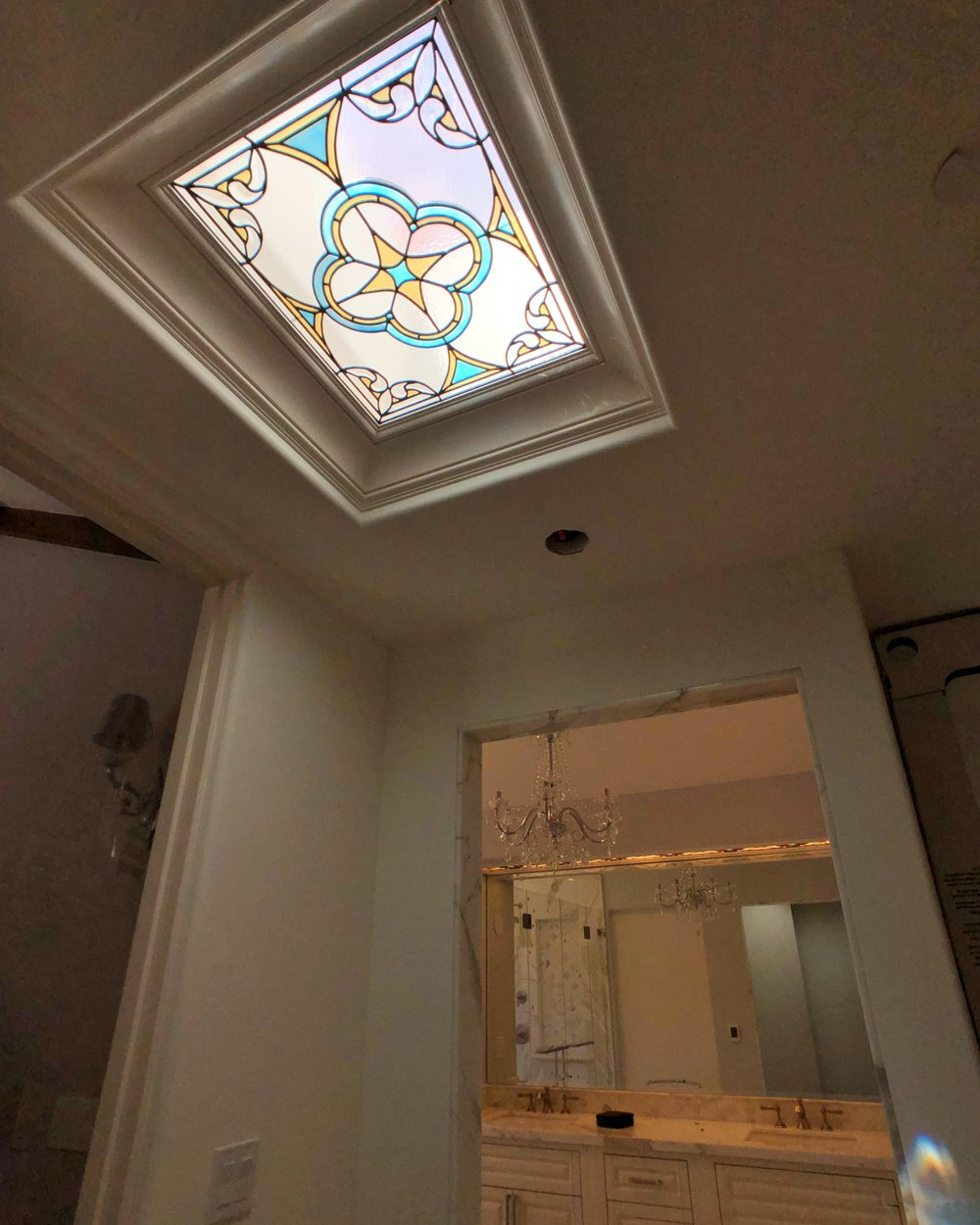 leaded glass stained glass custom design california legacy glass studios spanish quatrefoil design colorful beveled glass skylight rainbows master closet bathroom.jpg