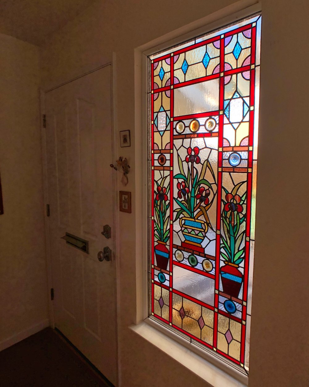 stained glass restoration british charm rondel floral before and after leaded glass legacy glass studios california front entry sidelight colorful custom glass repair.jpg
