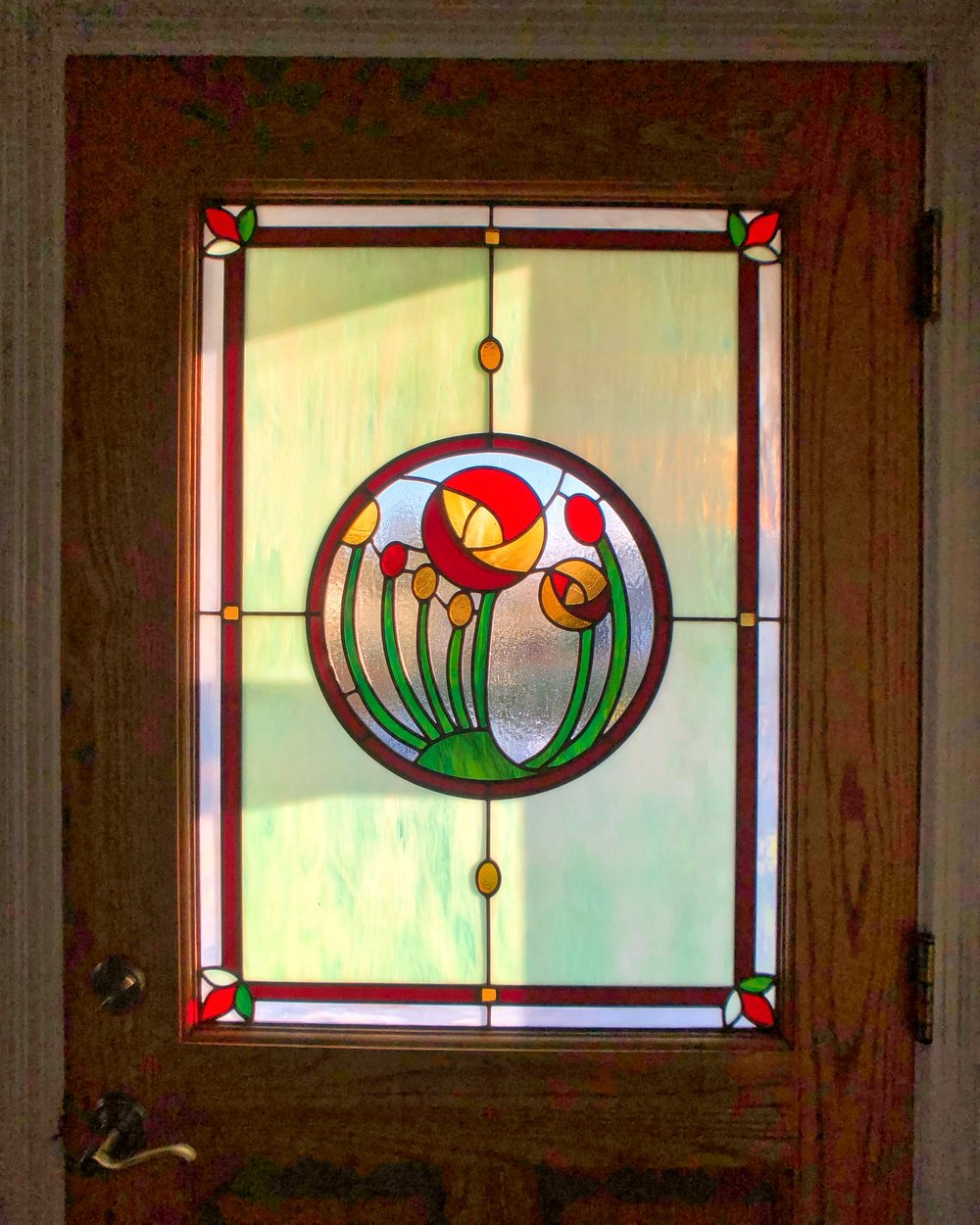 leaded glass stained glass art glass bay area custom design legacy glass studios design front door flowers front entry green red border leaves abstract sunset light opalescent.jpg