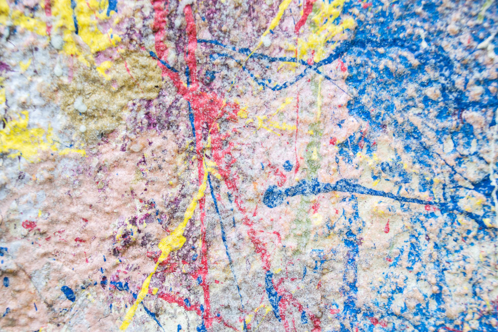 and the Jackson Pollock-y wall