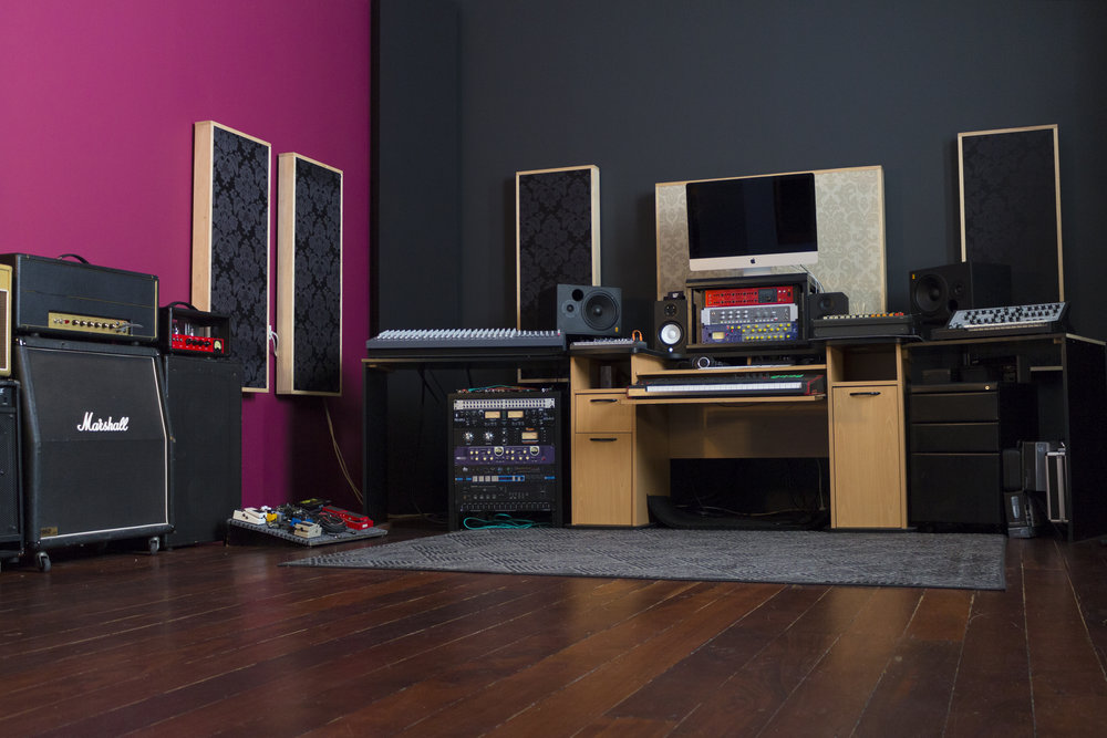 """Designed with engineer-musician communication in mind the """"Main Room"""" of The HAM Hub Boasts 48m2 of hardwood flooring, 3m high ceilings, 2 floor to ceiling bass traps, a naturally diffusive back wall,custom built diffusion and absorption panels, and all our rack gear at arms reach."""