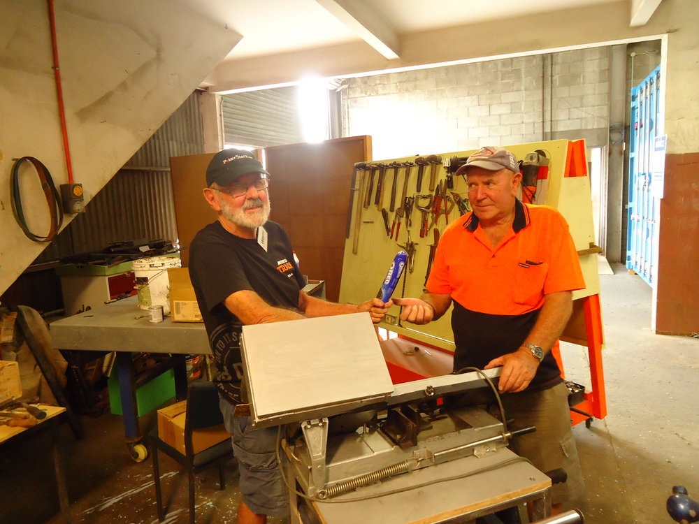 Wayne presents Colin with the Oreo Award for Innovation   A metal saw transformed