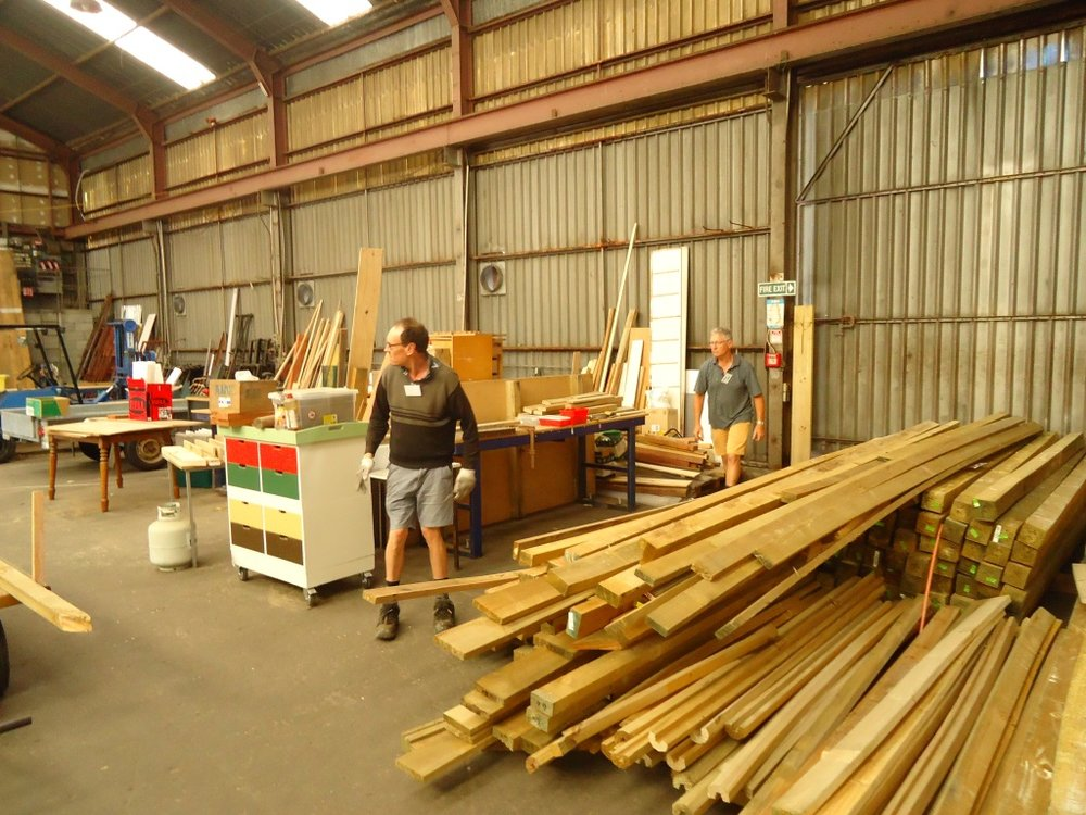 Trent assisting with timber storage.