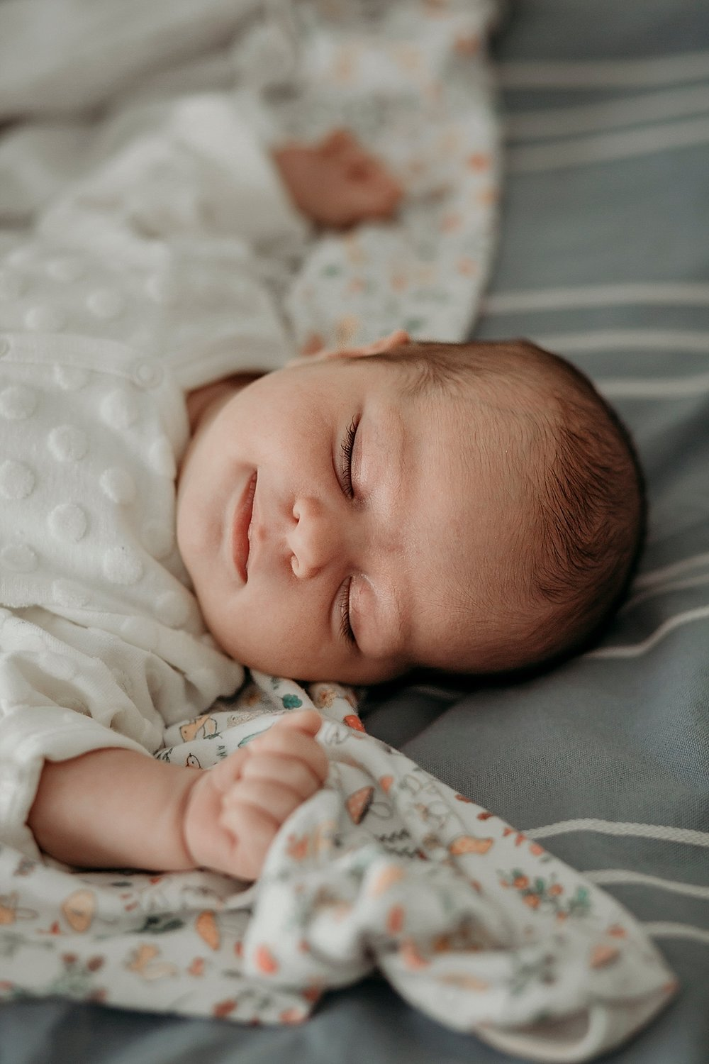 newborn  smiling in her sleep