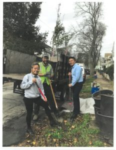 Quincy residents have received free shade trees through the Greening the Gateway Cities Program. Quincy Asian Resources Inc. CEO Philip Chong (right) planted trees with a volunteer and a Department of Conservation and Recreation team member. (Image courtesy of the City of Quincy.)