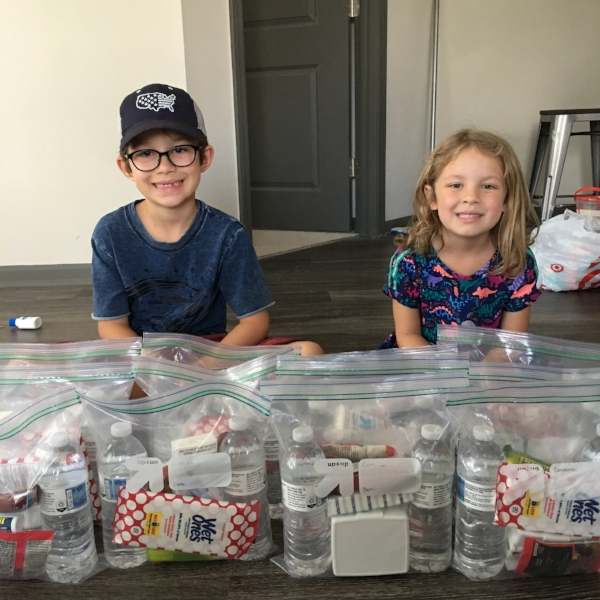 Kids with caring hands make care packages to hand out while driving through Jax.
