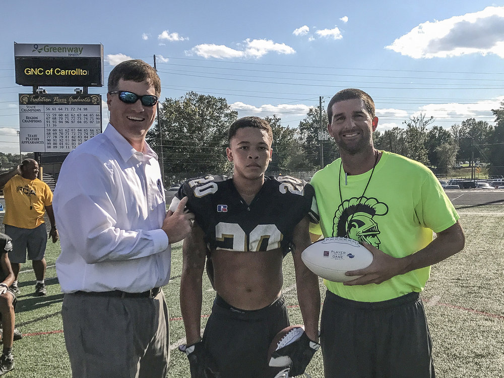 Head coach Sean Calhoun was presented the game ball for the Trojans as it was the Georgia Farm Bureau Insurance Game of the Week for the entire State of Georgia.