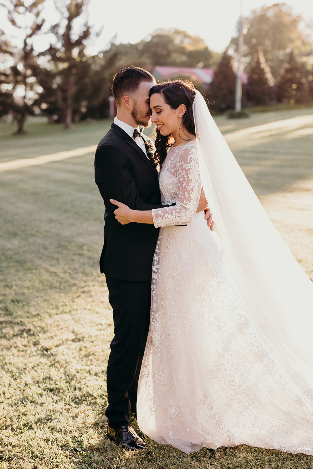 Alisha and Trent - August 2017 - What a wedding! Alisha had a customised Alisha overlay with fitted sleeves worn over an Ivory Cressida gown with detachable straps.In 2017 I had FIVE Brides with broken zips!! Luckily I was able to get to each and every one to stitch it closed before the ceremony. I have had the odd broken zip over the years but 5 in one year was not usual. Needless to say I have since found a new zip supplier with zero broken zips in 2018! Thank heavens I was a guest at Alisha and Trent's big day.Images by Tennille Fink