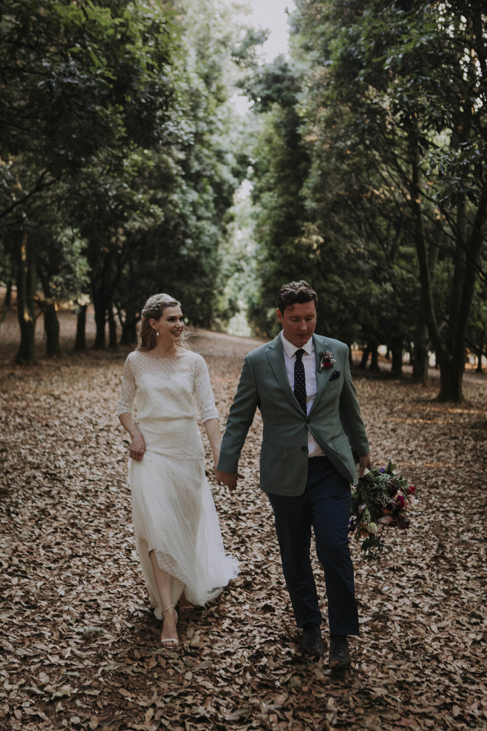 Angela and Sam - So I wanted to say first of all, thank you. Thank you for creating my gown which I could not have been happier with, that contributed to the best day I could have ever imagined! Our wedding in the Byron hinterland was absolute perfection to us. Sam was speechless when he finally saw me walking down the aisle in the dress, beaming like a Cheshire cat. I was so nervous leading up to the day, but when I woke up on the morning of the wedding and started getting ready I was bizarrely calm (for me) and as soon as I slipped into that polka-dot tulle and lace I felt so comfortable and I just knew that no matter what happened from that point on, the day would be magic because I felt 100% myself... but an even better version! So thank you for helping to create that magic. The whole journey with you in the gown creation was so much fun, I looked forward to each appointment with such anticipation and enjoyed the dress being revealed a little bit more with each fitting - I shall carry those fond memories with me forever, so thank you again!Angela Barbeler