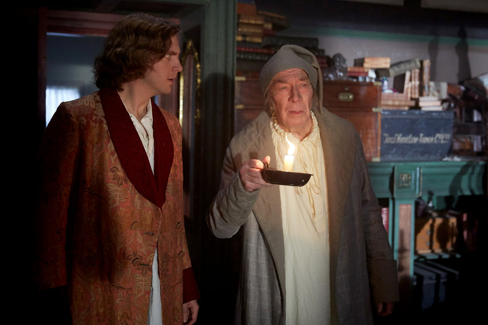 Scrooge (Christopher Plummer) tries to lead Dickens (Dan Stevens) to an elusive final chapter