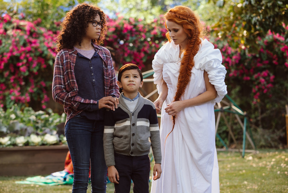 "Storm Reid, Derek McCabe and ""Universal Light"" worker Reese Witherspoon in A Wrinkle in Time"