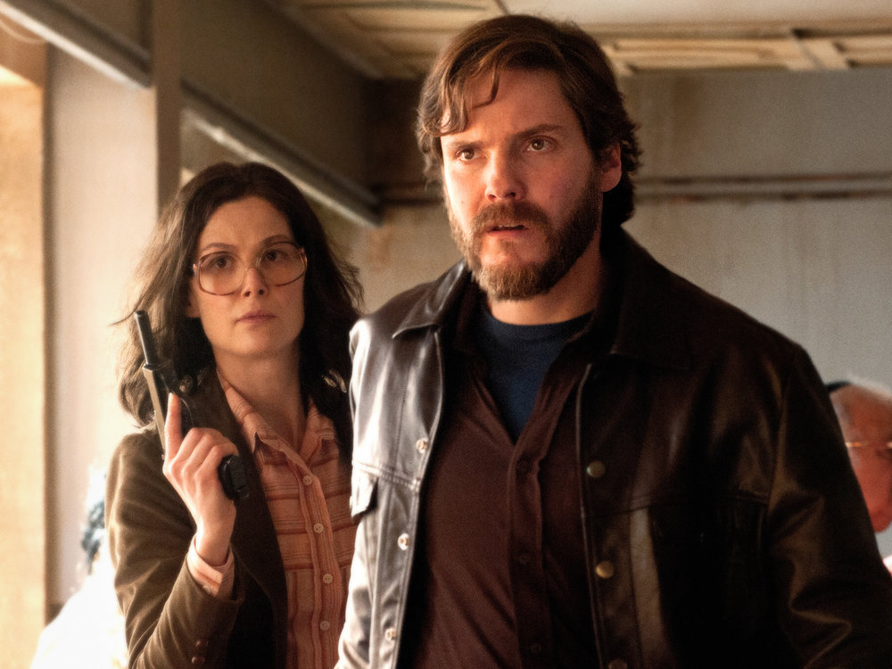 Rosamund Pike and Daniel Brühl as Baader-Meinhof Gang terrorists in 7 Days In Entebbe