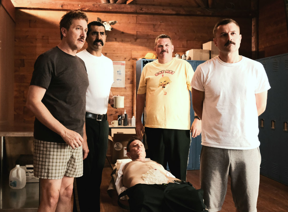 Super Troopers 2: Note crotch area in prostrate fellow...