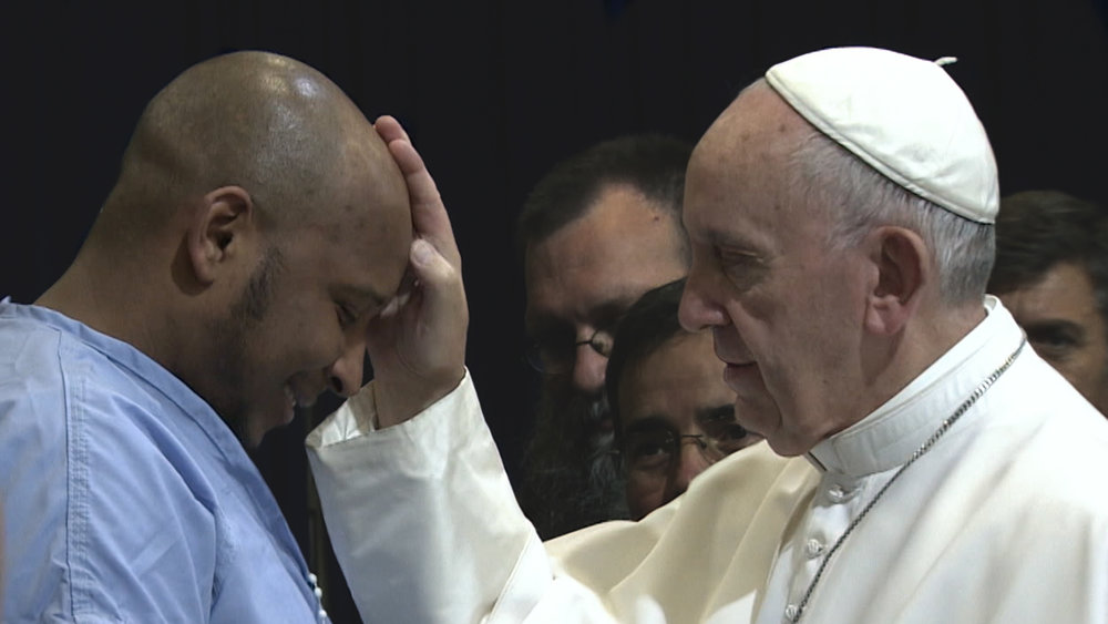 Pope Francis blesses an inmate in a Philadelphia prison.