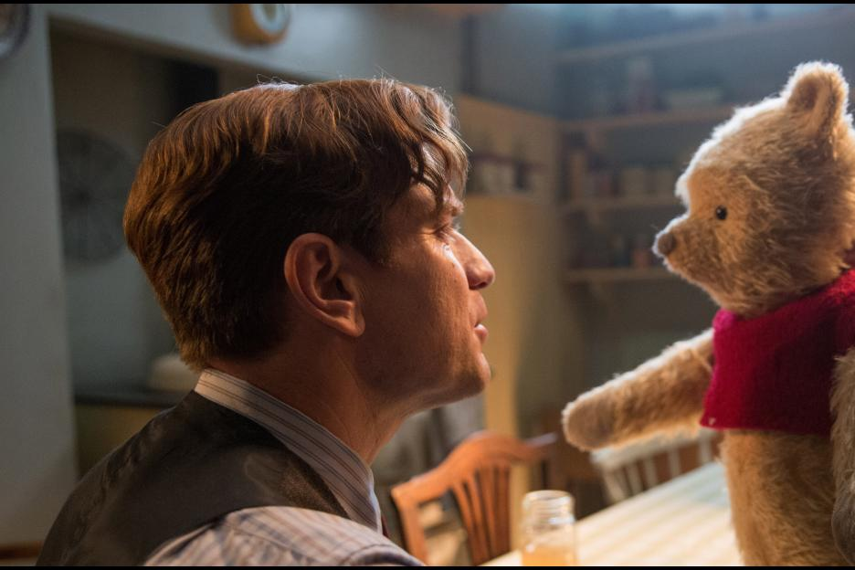 An uptight, adult Christopher Robin (Ewan McGregor) gets reacquainted with Pooh.